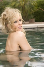 Beautiful blonde hottie, Julia Ann´s nipples are hard as rocks or maybe she was just so turned on by you watching her model her amazing big tits and hot body in her sexy black bathing suit!