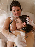 Lustful lesbians lather up in bath then toy quims in bed