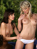 Luscious ladies lick and rub in torrid outdoor foursome