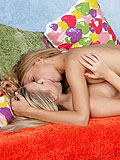 See sensual kisses as lesbian lovers cuddle and fondle pussy