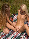 Nubile girls tantalise clit with tongues and toys outdoors