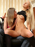 Luscious lesbians kiss and fuck tight twats in strapon romp