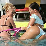Sultry stunners eagerly lick and finger wet twats in pool