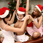 Cute Santa trio kisses and makes sweet love with strapon