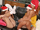 Watch three stunning teenies toying and kissing at christmas