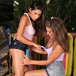 Ravishing brunette sirens kiss and dildo twats outdoors