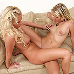 Lusty blonde teens lick and rub tight wet snatches together