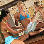Sizzling teen trio strips and fingers pink pussies on table