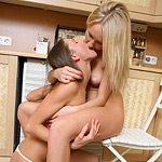 Slender honeys lovingly kiss and share dildo in kitchen