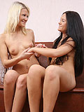 Graceful blonde and brunette rub and lick shaved pink twats