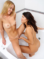 Sensual teens nude and dildo each others pussies in bathtub