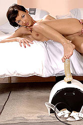 Brunette cutie riding the sybian