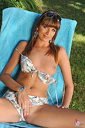 Alise Alanis stripteasing outdoors
