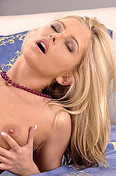 Hot blond Dana plays with a sex toy