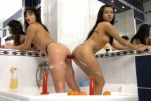 Dark haired bitches riding anal toys in bathroom