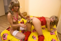 Pretty blondes dringing n fisting each in lingerie