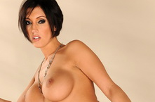 Sexy brunette babe stripping and showing her pussy