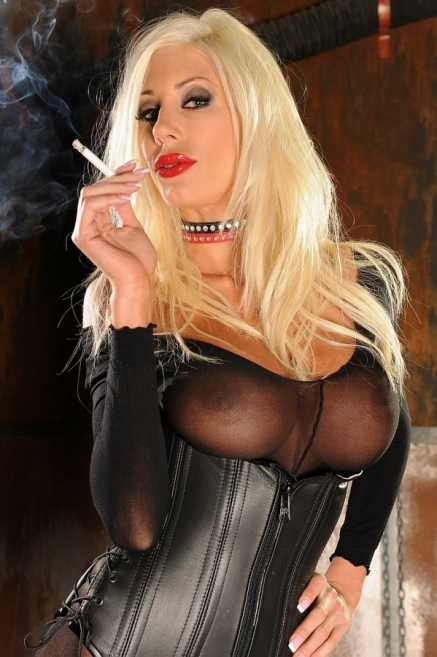 Very busty babe Puma Swede is smoking in stockings