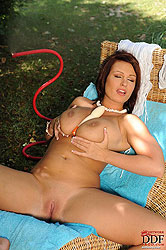 Busty LaTaya Roxx naked in garden