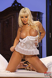 Cindy Dollar stripteasing on bed
