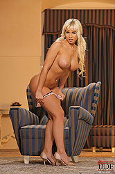 Blonde Cindy Dollar getting naked