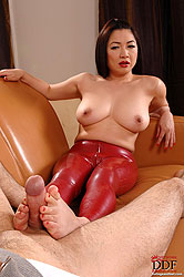 Asian MILF Midori giving footjob