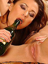 Hot babes fucking each with bottles of champagnes