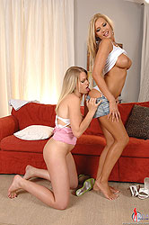 Hot babes share a huge rubber dildo
