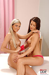 Oiled playful lesbians open wide