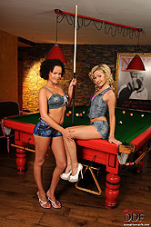 Two girls cue stick their assholes!