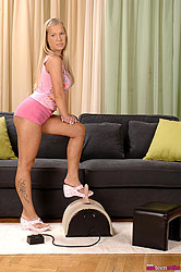 Blue eyed Kyra riding the sybian