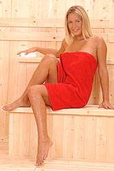 Naughty blonde toying in the sauna