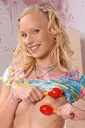 Teen Gitta Blond plays with rattles