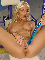 Nice titted Alexis playing with extra long dildo