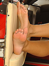 Zuzana pampering her stockinged legs in sport car