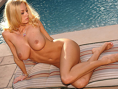 Blonde Anita Dark showing her sexy feet outdoor