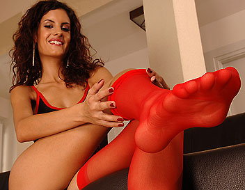 Sexy Leanna plays with her toes in red stockings