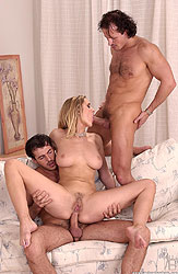 Busty Jane Darling takes 2 cocks