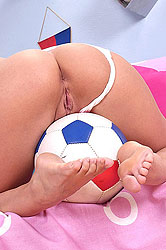 Sophie strips off her soccer kit