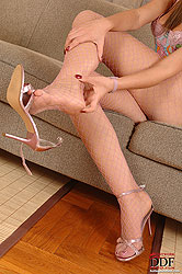 Bambi posing legs & feet in fishnet
