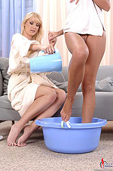 Two young blondes have lesbian bath