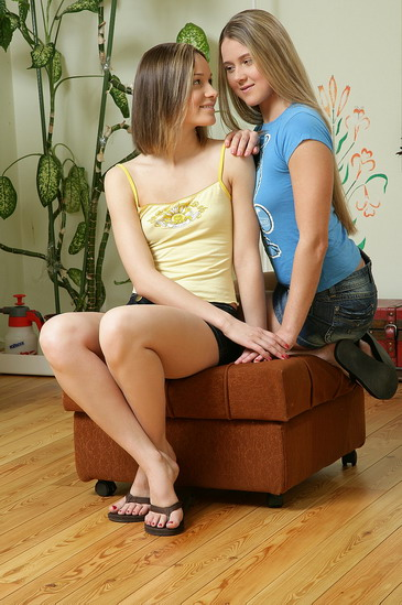 Lesbian teen lovers playing with a strap-on dildo
