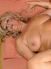 Tattooed old slut eats hard dick with her pussy