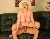 Hot granny takes a young cock into her hairy pussy