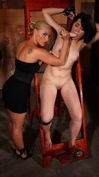 Blonde domina stuffing dildo into her victim