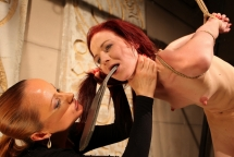 Niki Fox and Katy Parker in a hc BDSM lezdom act