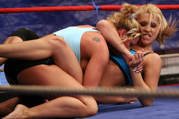 Pretty blonde girls fighting and licking each