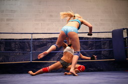 Hot girls are fighting in a ring and having sex