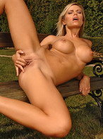 Busty sexmachine angel dildoing in the garden