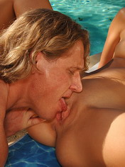 Sexy couple is having hot sex at side of the pool